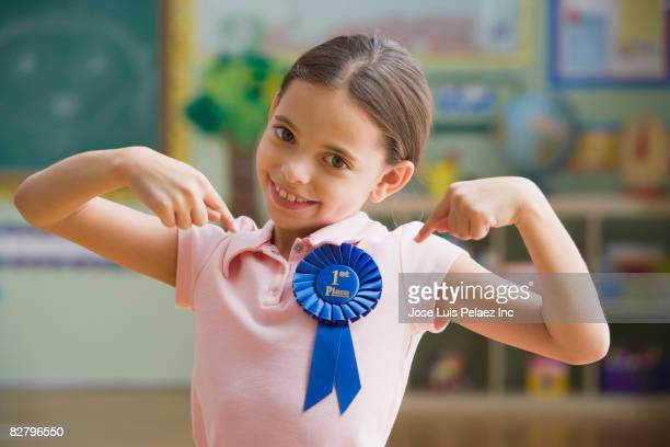 hispanic girl wearing first place ribbon - vanity stock pictures, royalty-free photos & images