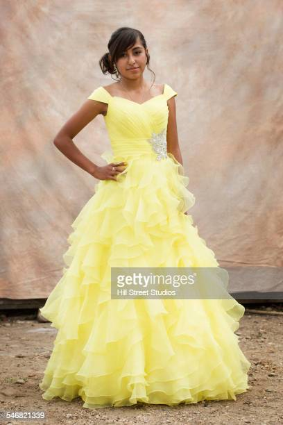 Hispanic girl wearing quinceanera dress