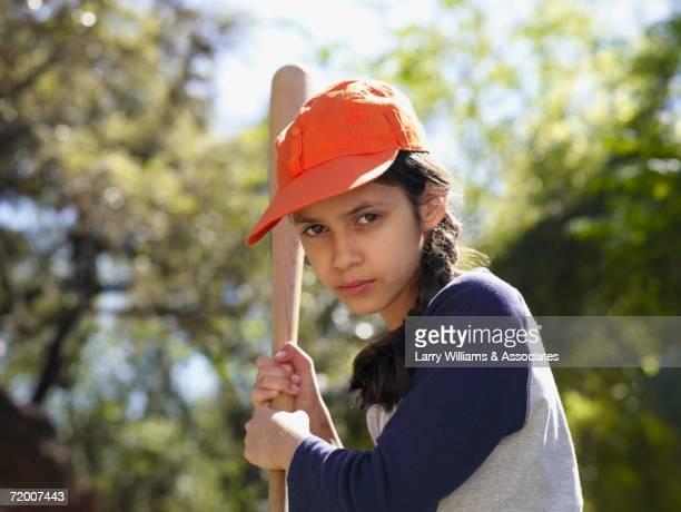 hispanic girl with baseball bat - bate fotografías e imágenes de stock