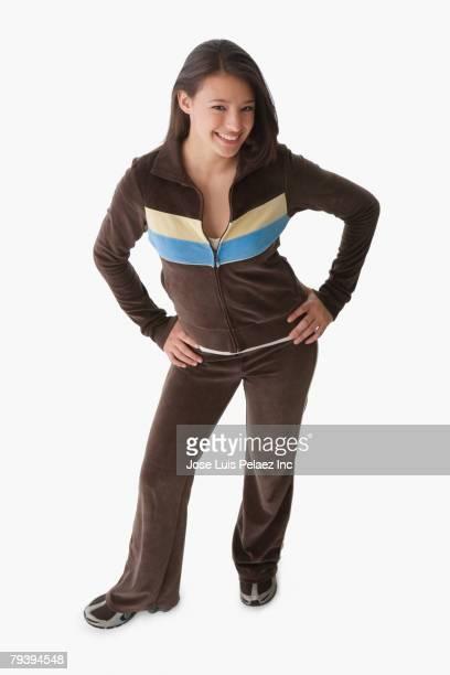 hispanic girl with hands on hips - hands in her pants fotografías e imágenes de stock