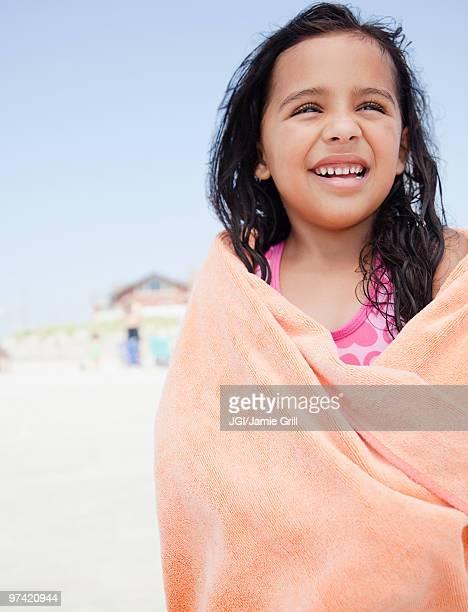 Hispanic girl wrapping up in towel