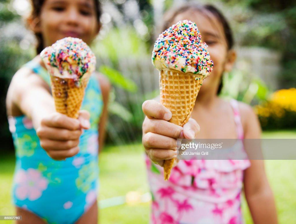 Hispanic girls eating ice cream cones : Stock Photo