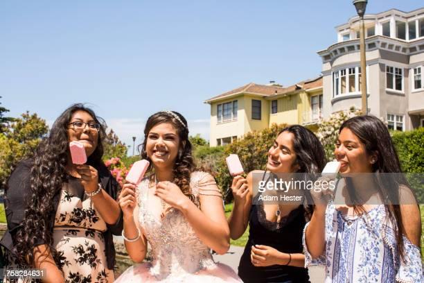 Hispanic girls eating popsicles