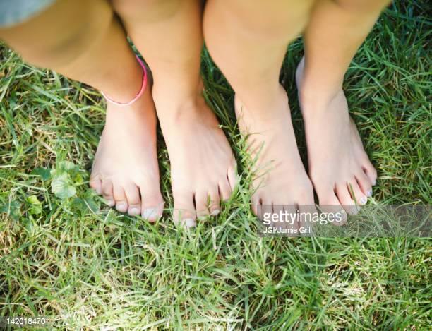 Hispanic girls feet standing in grass