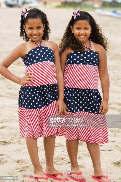 Hispanic girls in sundresses on beach