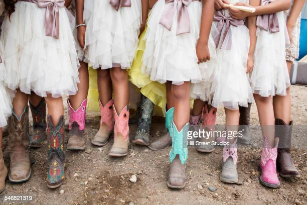 Hispanic girls wearing cowboy boots at quinceanera