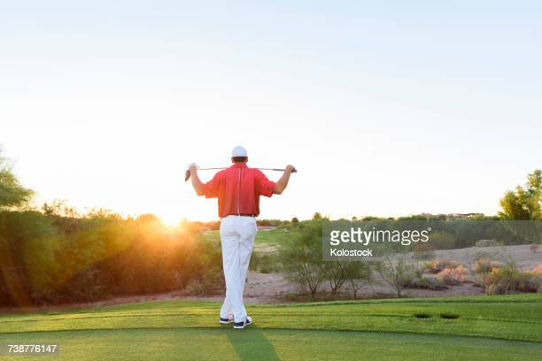 hispanic golfer waiting on golf course - driver golf club stock pictures, royalty-free photos & images