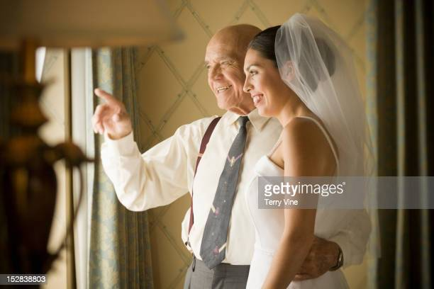 hispanic grandfather hugging bride - generation gap stock pictures, royalty-free photos & images