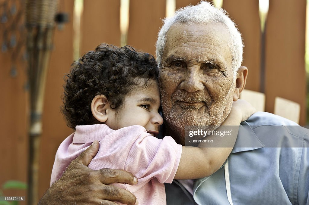 Hispanic grandfather with his grandson : Stock Photo