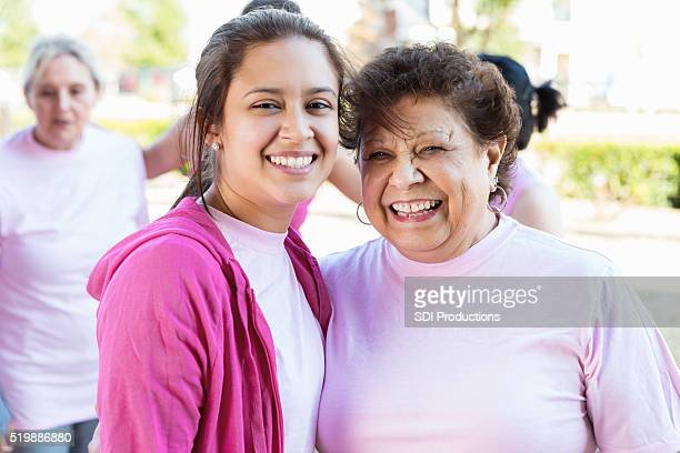 Hispanic grandmother and granddaughter at charity event