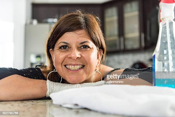 Hispanic housewife posing at her kitchen