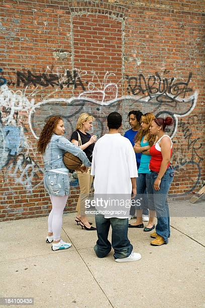 Hispanic kids meeting with a female social worker
