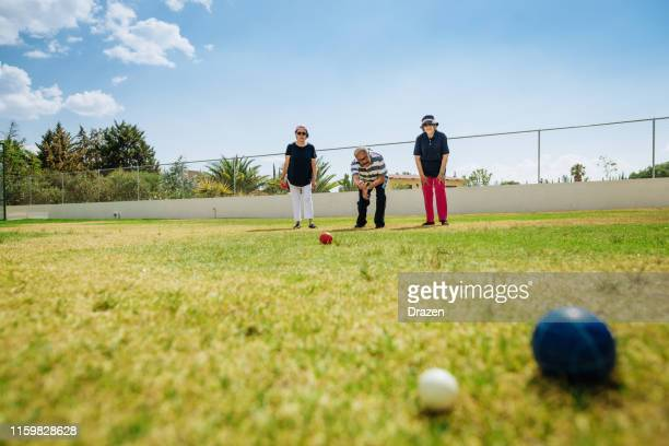hispanic latino people playing boules in summer - wide angle stock pictures, royalty-free photos & images