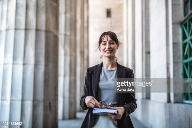 hispanic law student in mid 30s at entrance to building - argentina stock pictures, royalty-free photos & images