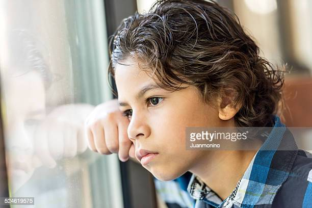 hispanic little boy - autism spectrum disorder stock photos and pictures