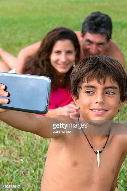 Hispanic little boy posing with his parents