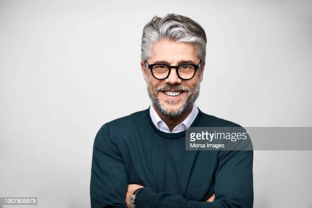 hispanic male entrepreneur against white background - beautiful people stock pictures, royalty-free photos & images