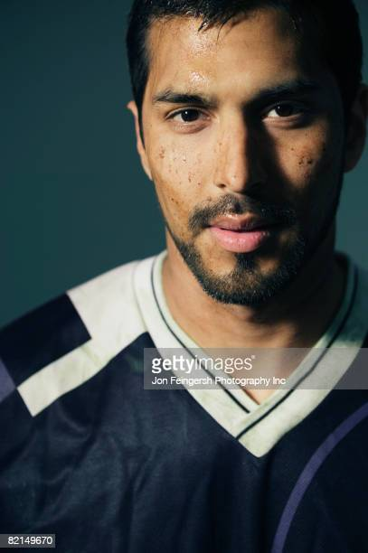Hispanic male soccer player with dirt on face
