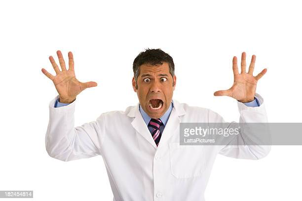 hispanic male wearing lab coat gesturing and making a face - cross eyed stock pictures, royalty-free photos & images