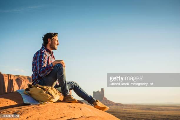 Hispanic man admiring view in remote desert