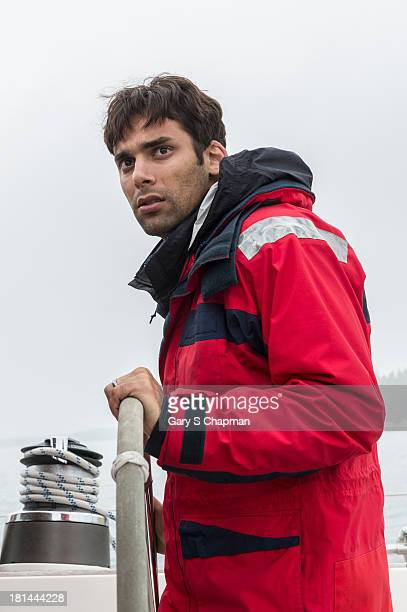 Hispanic man at sailboat helm