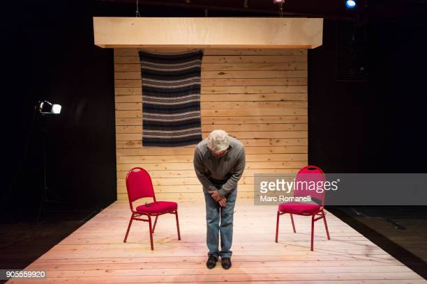 Hispanic man bowing on theater stage