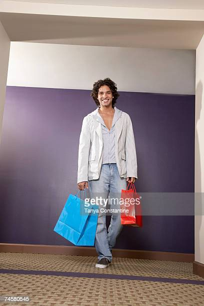 Hispanic man carrying shopping bags
