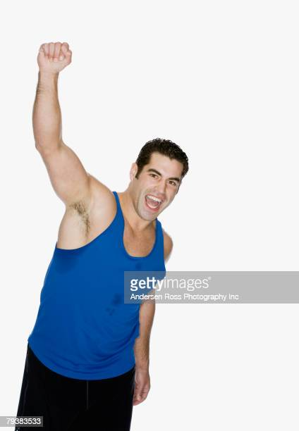Hispanic man cheering with arms raised