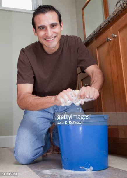 hispanic man cleaning bathroom floor - daily bucket stock pictures, royalty-free photos & images