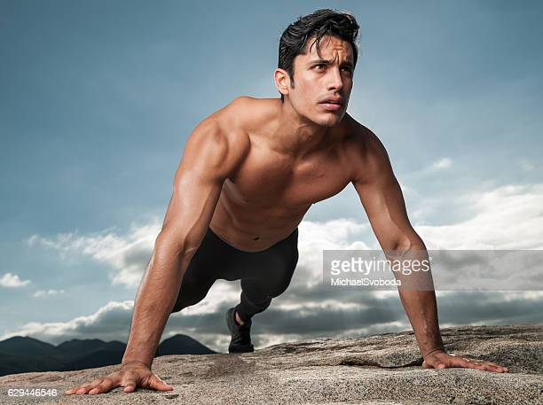 hispanic man doing push ups outdoors - handsome mexican men stock pictures, royalty-free photos & images