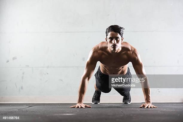 hispanic man doing push ups - push ups stock pictures, royalty-free photos & images