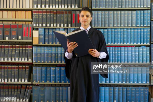 hispanic man doing research in library - judge stock pictures, royalty-free photos & images