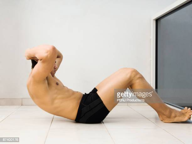 Hispanic man doing sit ups