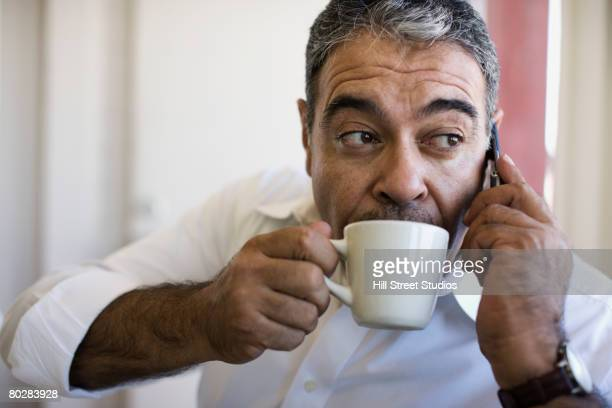 Hispanic man drinking coffee