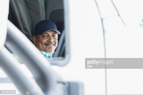 hispanic man driving a semi-truck - trucker's hat stock pictures, royalty-free photos & images