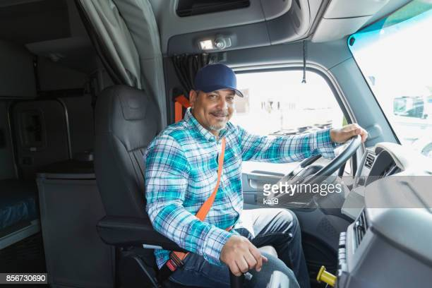 hispanic man driving a semi-truck - truck driver stock pictures, royalty-free photos & images