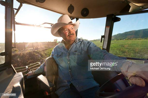 Hispanic man driving tractor