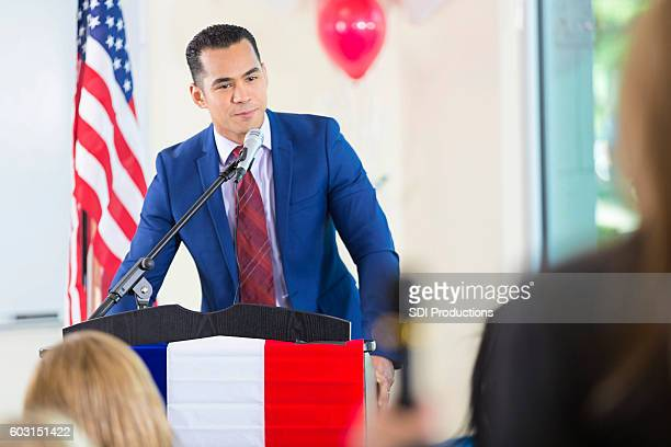 hispanic man giving speech while running for political office - town hall meeting stock photos and pictures