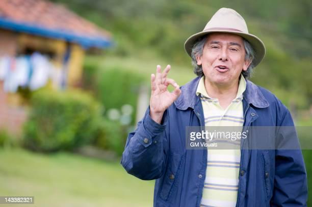 Hispanic man making okay gesture
