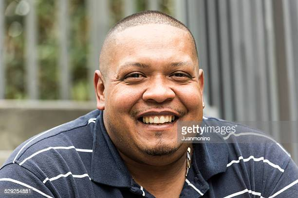 hispanic man - fat black man stock photos and pictures