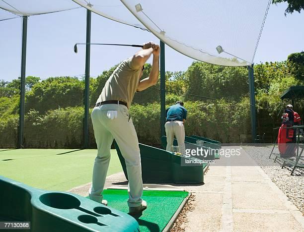hispanic man playing golf - driving range stock pictures, royalty-free photos & images