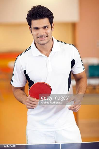 Hispanic man playing ping pong