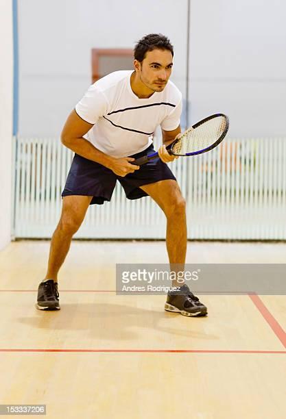Hispanic man playing squash