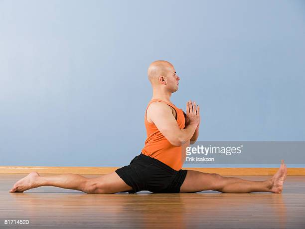 hispanic man practicing yoga - doing the splits stock pictures, royalty-free photos & images