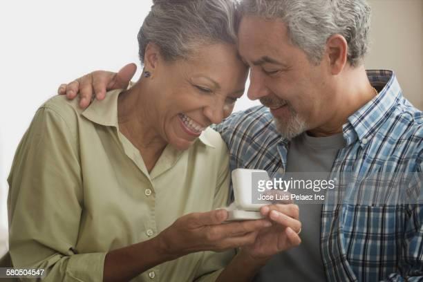 Hispanic man proposing to girlfriend