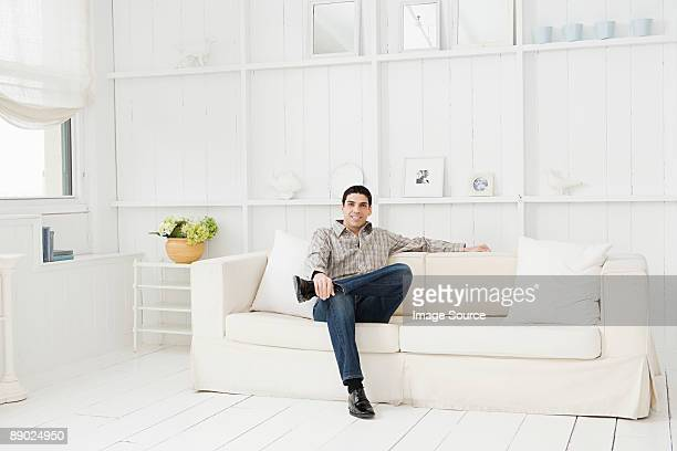 Hispanic man relaxing on a sofa