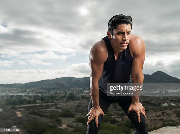 hispanic man resting from workout - handsome mexican men stock pictures, royalty-free photos & images