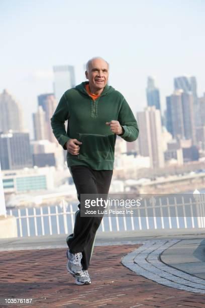 Hispanic man running in urban setting