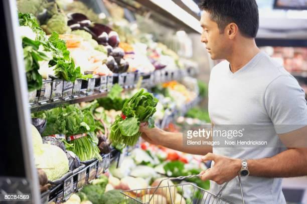 Hispanic man shopping for produce