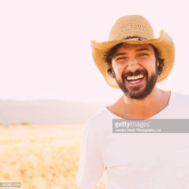 Hispanic man smiling in remote field